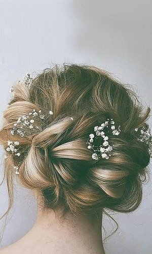 chignon and flowers wedding hair