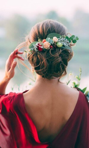 messy flowers chignon wedding hair