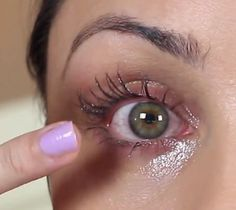 applying oil to lashes