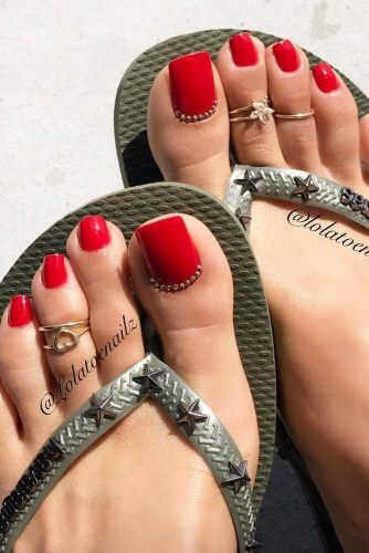 red rhinestones toe nail design