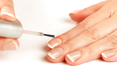applying clear nail polish